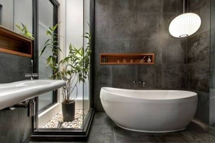 Zen bathroom design with grey walls and round globe for Best bathrooms in australia