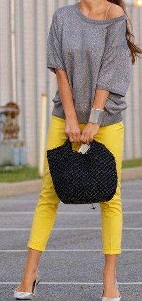 Yellow pants & heather gray sweater paired with silver accessories.