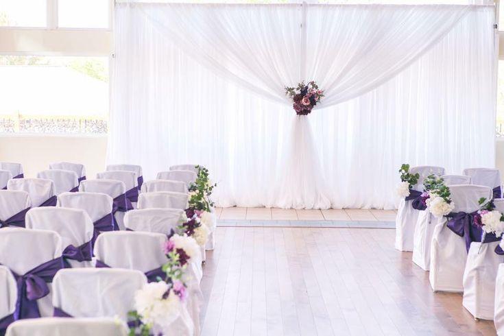SUmmer Wedding #cldesigns #cldesignteam #newbrunswickweddings #purplewedding #weddingbackdrop #fauxflowers #purpleflowers #chaircovers #pewmarkers #weddingbackdrop