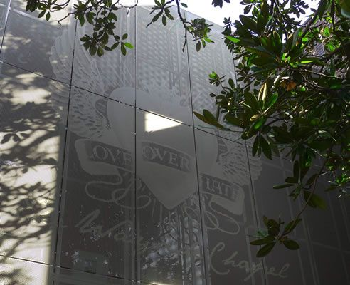 Photographic perforated metal facade with DecorMetl