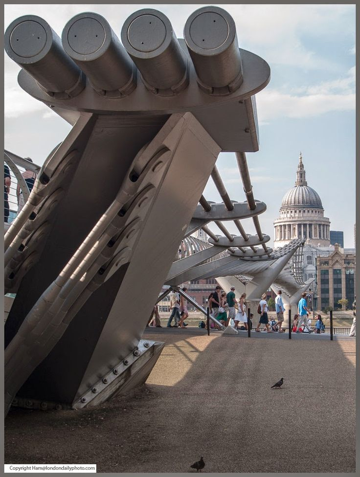 The Millennium Bridge and St Paul's Cathedral, London. The Millennium Bridge was designed by architect Norman Foster and of course St Paul's by Sir Christopher Wren