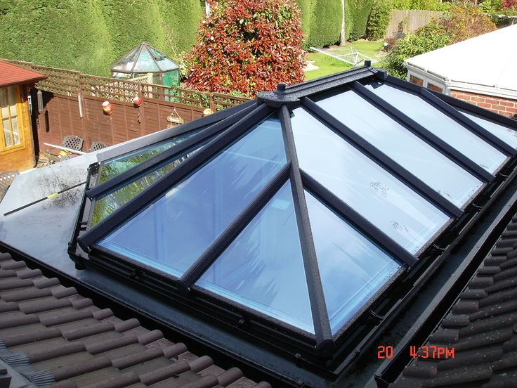 An Orangery style glass roof installed to a flat roof extension to allow plenty of light.
