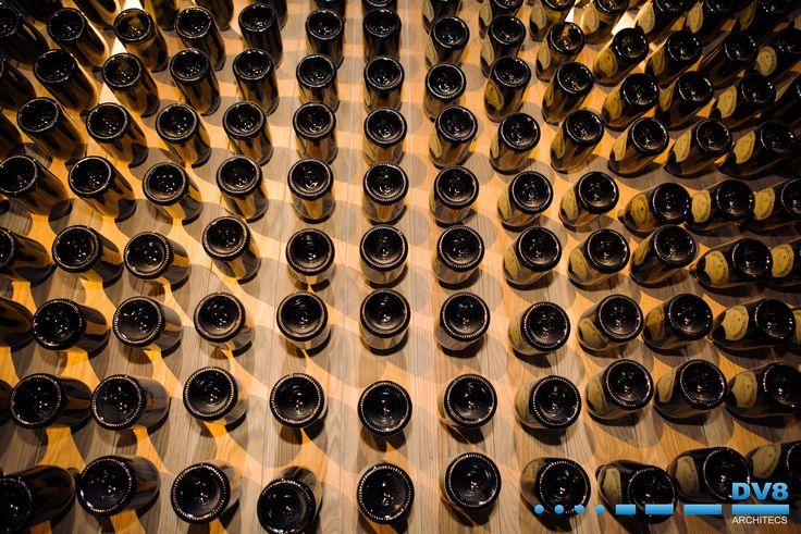 Ellerman House Wine Gallery Champagne Cellar. Traditional riddling racks given a new modern twist in oak.