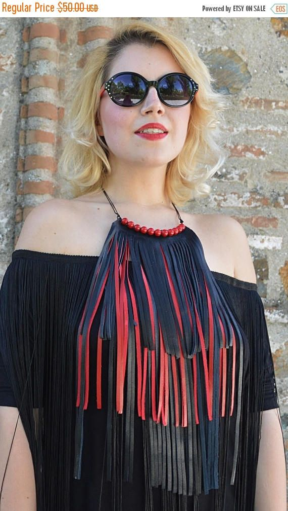 Extravagant leather fringe necklace with long playful black and red fringes, red coral beads and waxed cotton thread. A perfect match with the black loose jumpsuit with fringes from the new CAROUSEL collection. Lets take a ride in the extravagant CAROUSEL!  Material: 100% genuine leather