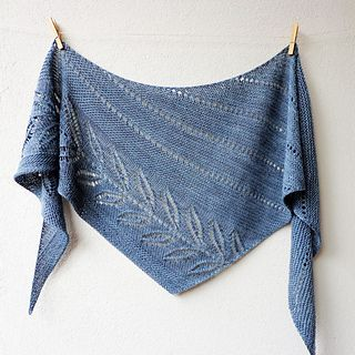 This lovely shawl features a beautiful leaf lace which is framed by garter stitch and fine eyelet lines. It will add an elegant, light accessory to your daily wardrobe.