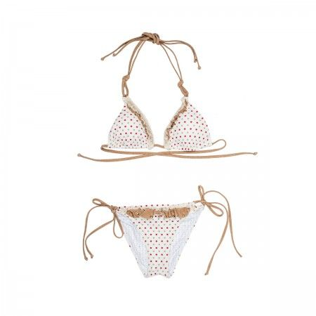Two piece swimsuit with white patterned print. Triangle bikini top and bottom with beige adjustable laces and ruffles.