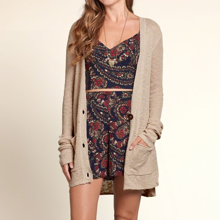 Girls Boyfriend Cardigan | Perfect to layer with textural stitch detailing, front pockets and three-button closure, a slouchy silhouette with side slits and hi-lo hem, comfortable ribbed trims, Easy Fit | HollisterCo.com
