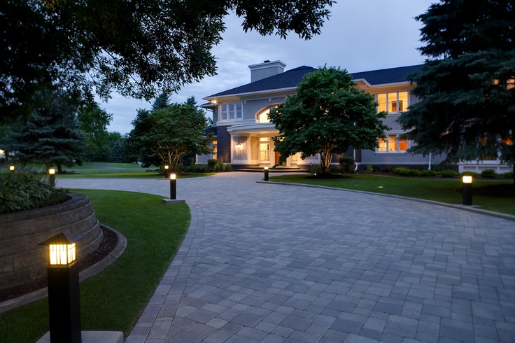 Wide paver circular driveway with bright path lights to for Driveway landscape lighting