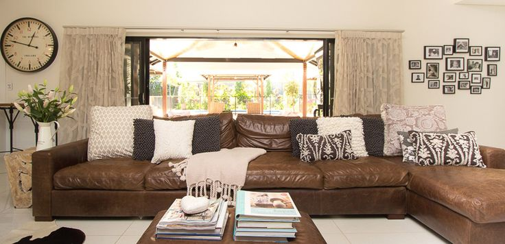 Living area with outdoor area and pool behind (SD Interiors)