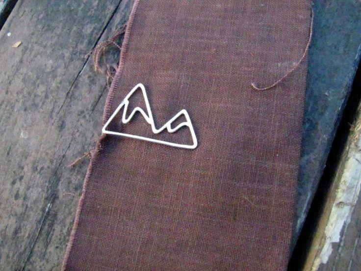 mountain tie clip   http://emmalinebride.com/rustic/mountain-wedding-ideas/