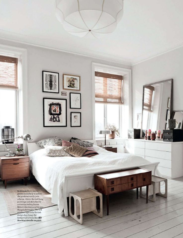 white walls, white bed, low bed, white dresser, gallery wall, woven shades, matching nightstands