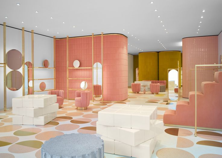 Bubblegum-pink and mustard-yellow velvet panels have been used for the interior of this London fashion boutique for RED Valentino.