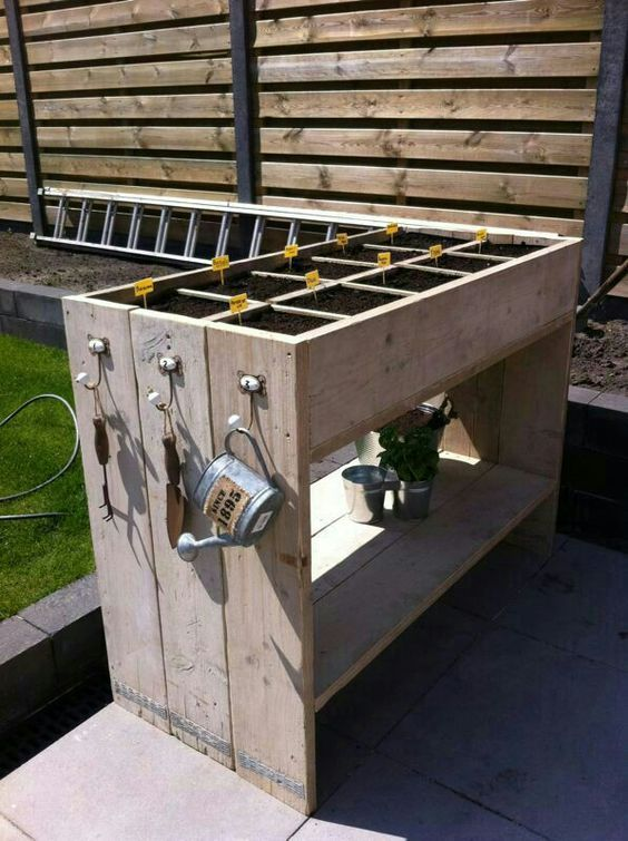 Pallet / Recycled wood herb garden. I like the way the end upright panels make it look like its made up of 3 sections ;):