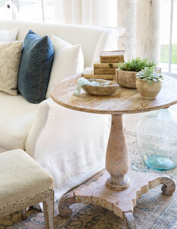 round end table, footstool and pillows