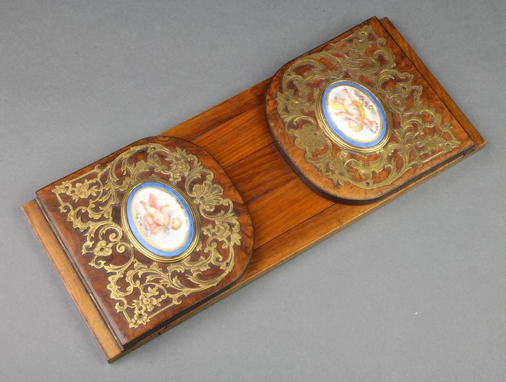 "LOT 952, A pair of Victorian walnut and gilt mounted expanding book ends, the ends set 2 ""Sevres"" blue porcelain panels decorated cherubs 4 1/2""h x 15""w and 23"" when extended SOLD £110"