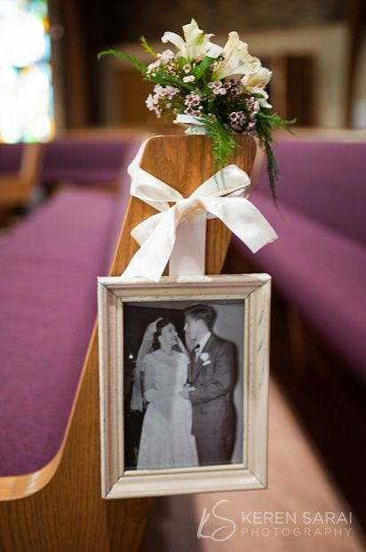 What a cool idea! Wedding photos from parents and grandparents' weddings hung on the pews or photos of the bride and groom as children.  Hers hung on her family's pews and his on his family's pews.
