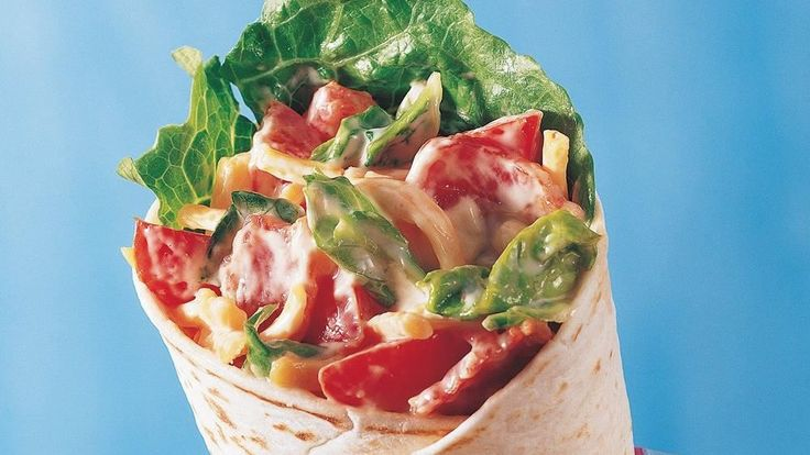 Fill bacon, lettuce and tomato mixture in tortilla wraps to make these easy and delicious burritos - ready in 10 minutes. Perfect for a Mexican dinner!