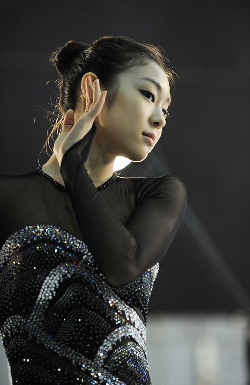 Yuna Kim (Wins Gold in Figure Skating )