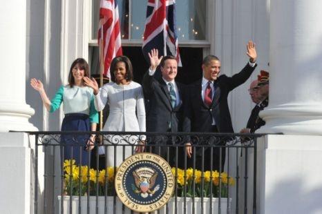 Barack Obama and David Cameron do a forthright leader-like wave. Samantha Cameron and Michelle Obama do a dainty wife-like wave.