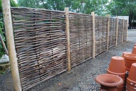 Belgian hazelwood fencing panels - drop posts 4 feet below grade to secure fence.