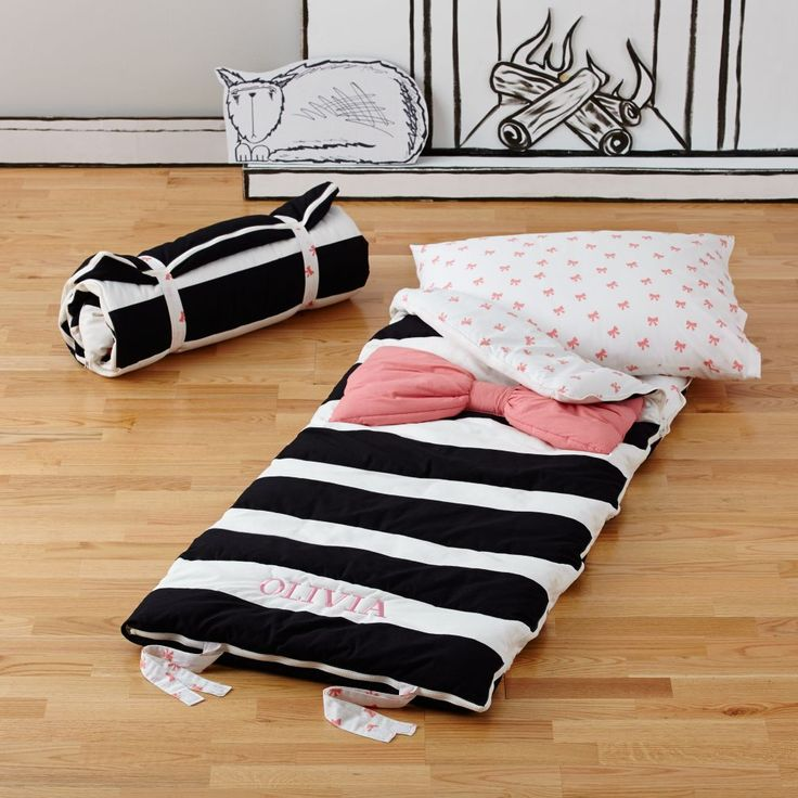 Sometimes you just want to wear a bow tie to bed. At least we did. So we designed our Candy Bow Sleeping Bag. It's perfect for adding a touch of chic to your slumber party. The black and white striped design gives it a sophisticated look, while the bright pink bow adds a playful pop of color. Personalize it with your child's name for an extra special touch.<br /><br /><NEWTAG/><h2>Details, details</h2><ul><li> Nod exclusive</li><li> Personalize with a child's name in pink up to 12…