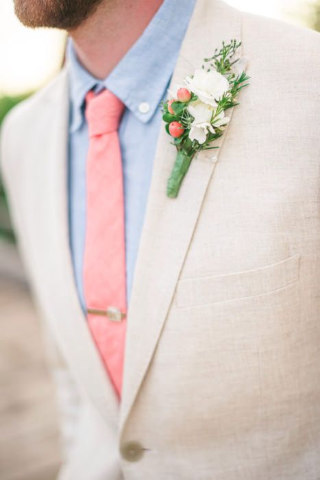 Light coral tie, blue shirt and a touch or coral in a white boutonniere. Source: Spottswood Photography #groomattire #coral