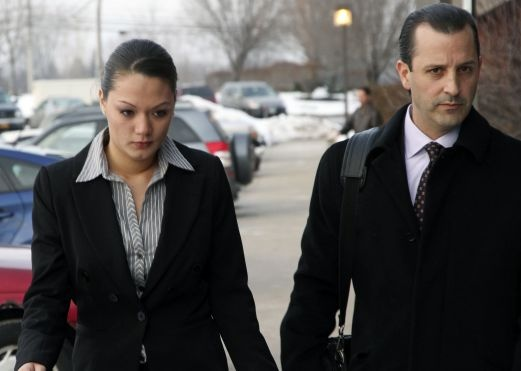 A woman who bought two guns used by a former neighbor in a deadly Christmas Eve ambush of firefighters has pleaded not guilty to a state charge of filing a falsified business record.