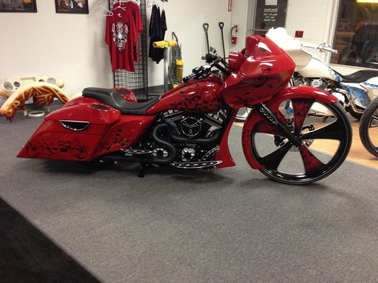 """Camtech Custom Baggers builds a tagged and bagged 2011 Harley-Davidson Road Glide custom with a giant 30"""" front wheel and a wild graffiti paintjob."""