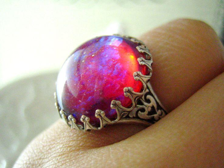 Lycoris-- Dragon's breath large opal glass stone antique silver brass adjustable ring. $32.00, via Etsy.