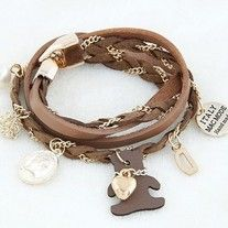 This leather wrap-around bracelet has a very cute teddy bear charm and different other elements.   Length: 380mm Metals Type: Zinc Alloy