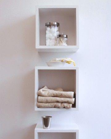 Keep bathroom necessities neat and accessible with cubbyhole shelves for large items and surgical jars for small toiletries and accessories.