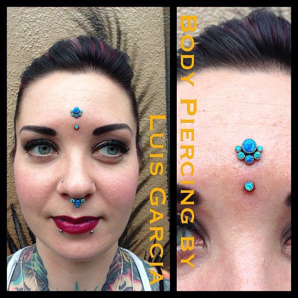 Fresh vertical bridge on Meemers with custom made Anatometal surface bar, 6 stone gem cluster (designed by me) on the top with dark blue opals, light blue opals, and mint green cz and dark blue opal on the bottom  (at NoKaOi Tiki Tattoo and Piercing)