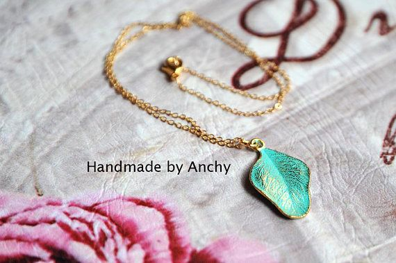 Cute small gold plated tree leaf with green patina pendant