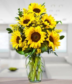 Sunflowers :) make me think of Granny & Grandpa & that makes my heart smile!  I still miss yall...
