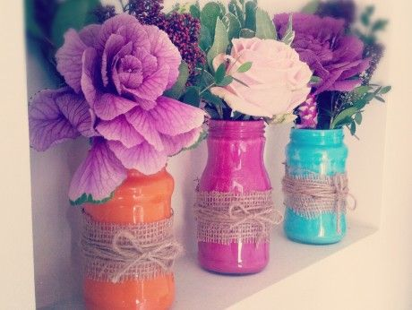 Painted jam jar/ glass jar DIY.   Beautiful decorative glass votives to house faux flowers; made using tester pots of emulsion paint and old mixed glass jars and bottles. Try it!