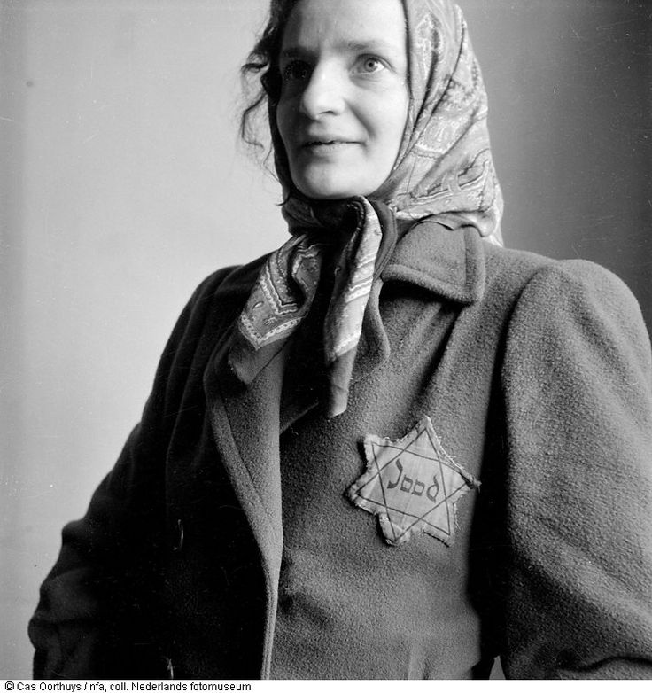 Anka Nienhuis-Szymelmic posing in her jacket with the Star of David. Amsterdam, The Netherlands (1944-1945).