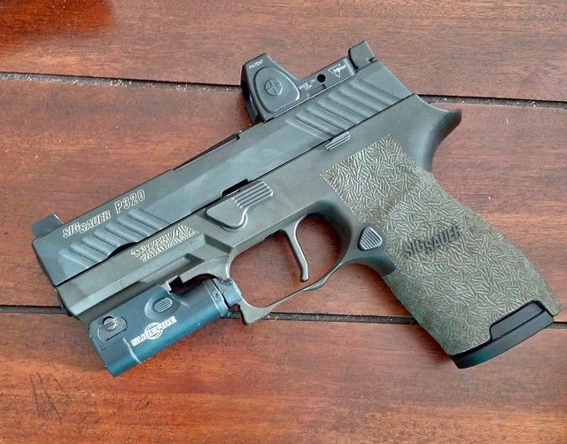 Sig Sauer P320 Compact with Trijicon RMR, Surefire XC1, and Apex Tactical flat trigger. I'm not going to lie, I've been looking at a Glock 19 as an alternative carry gun to my G43, but this thing is...