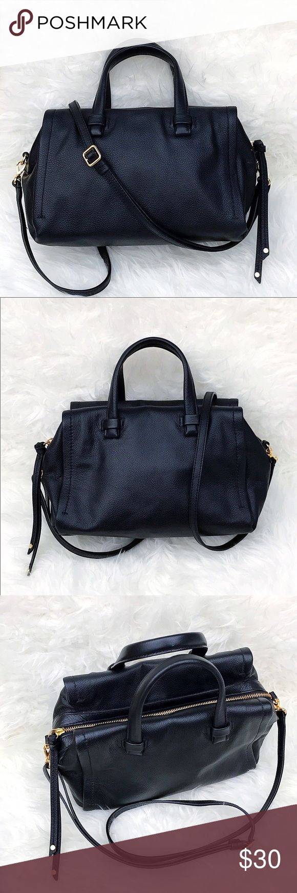 Banana Republic Black Leather Satchel Handbag Banana Republic Black Leather Satchel Handbag. This gorgeous everyday satchel features an all black leather body, gold hardware, and black fabric interior lining. Condition: Gentle Use Banana Republic Bags Satchels