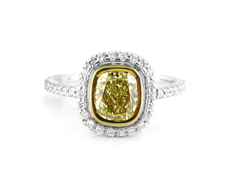 An 18ct White and Yellow Gold and Yellow Cushion Cut Diamond Halo Ring