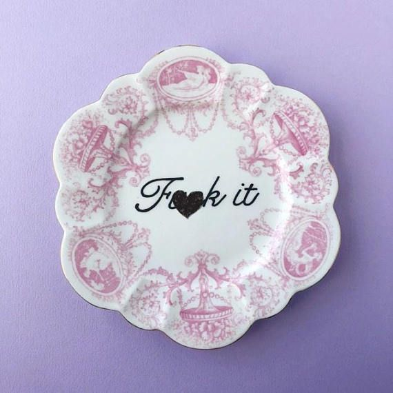 Vintage pink side plate, hand painted with the phrase Fuck It. All of our vintage treasures are unique. We individually source and hand paint our designs using the best quality materials in our Bristol studio. Our beautifully defaced vintage comes gift wrapped in brown paper packages