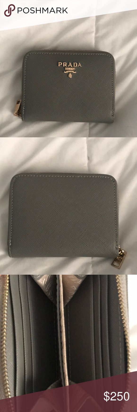 Prada Wallet Gifted to me and my sister a year ago, never used them sadly, they're both basically new and really cute. Has 2 main pockets and two sides have 3 card holders. Really good christmas gift!!! I️ WILL BARGAIN THE PRICE!! Prada Bags Wallets