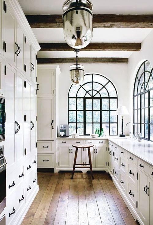 white kitchen with dark brown accents