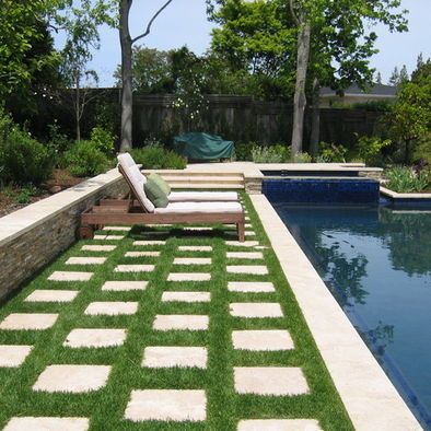 Clean and simple. Mondo grass, checkerboard pavers. Love this idea for a patio or a walkway
