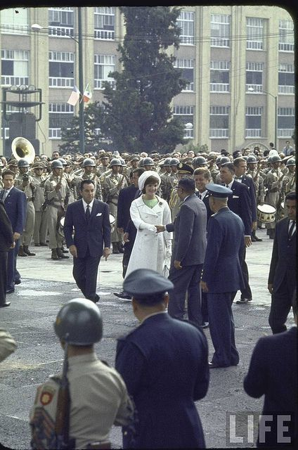 Pres. John F. Kennedy and his wife Jacqueline greeting officials during a state visit to Mexico. July 1962...She is stunning.