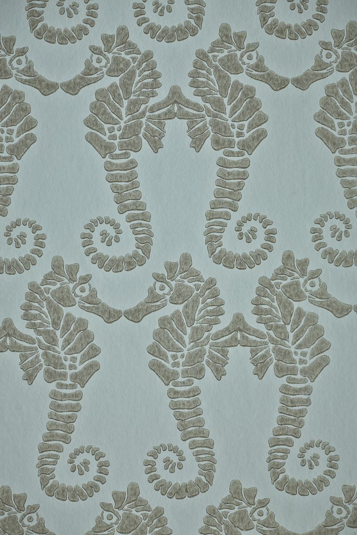 Kissing seahorses. This pattern is delightfully elegant with the symbols of power kissing, forming a very nice pattern that anyone will love. This wallpaper is printed in gold on charcoal or soft gold