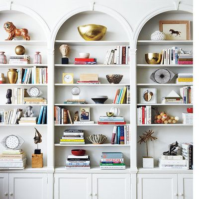 "It seems like a no-brainer to use cabinets for storage, but make sure to maximize the space that's in there. Professional organizer Beth Penn says, ""If you have at least 12 inches of space between shelves, that's an opportunity to add an extra shelf for even more storage space."