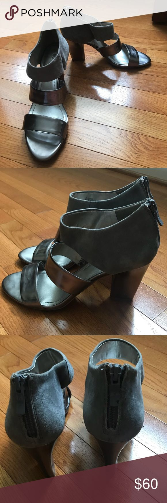 BCBGeneration gray and silver open toe heels Style is called PL-Orianthi.  Gray and silver with suede and metallic leather strappy heels.  Minor scuff pictured on heels.  Zipper in the back makes it easier to put the shoes on.   Heel is 3 inches.  Beautiful heels to wear for a formal event.  Size 8.5 BCBGeneration Shoes Heels