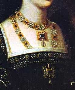 Tudor era accessories: Necklaces. In Anne Boleyn's time, the fashion was to tuck the longer necklace inside the square neckline of the gown.