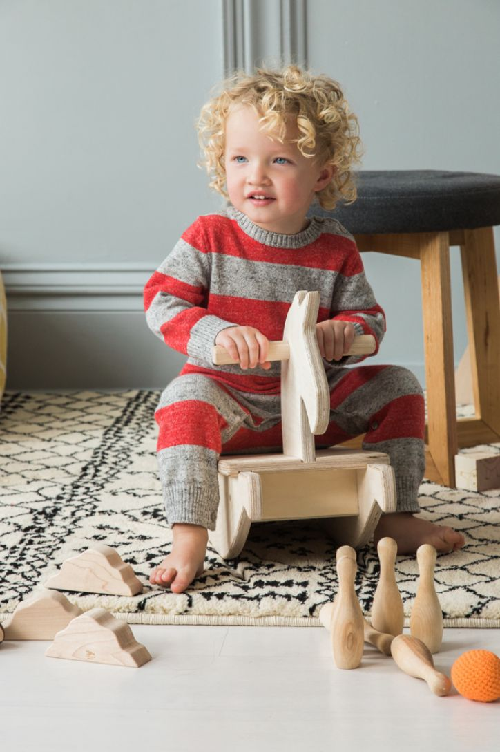Amazing vendors and clothing in the STRIVE Holiday gift Guide 2014 - being released Monday December 1st  Wooden Toys: http://www.littlesaplingtoys.com/ Rug and gray stool: Target Romper: Baby GAP stay tuned to find it along with amazing deals and coupon codes. Photo Credit: Alyssa Vincent