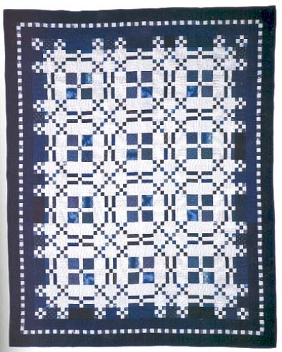Blue and White Burgoyne Surrounded quilt made by Marsha McCloskey
